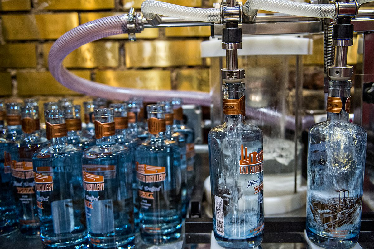Bottles of vodka being filled at Old 4th Distillery on Edgewood Avenue.