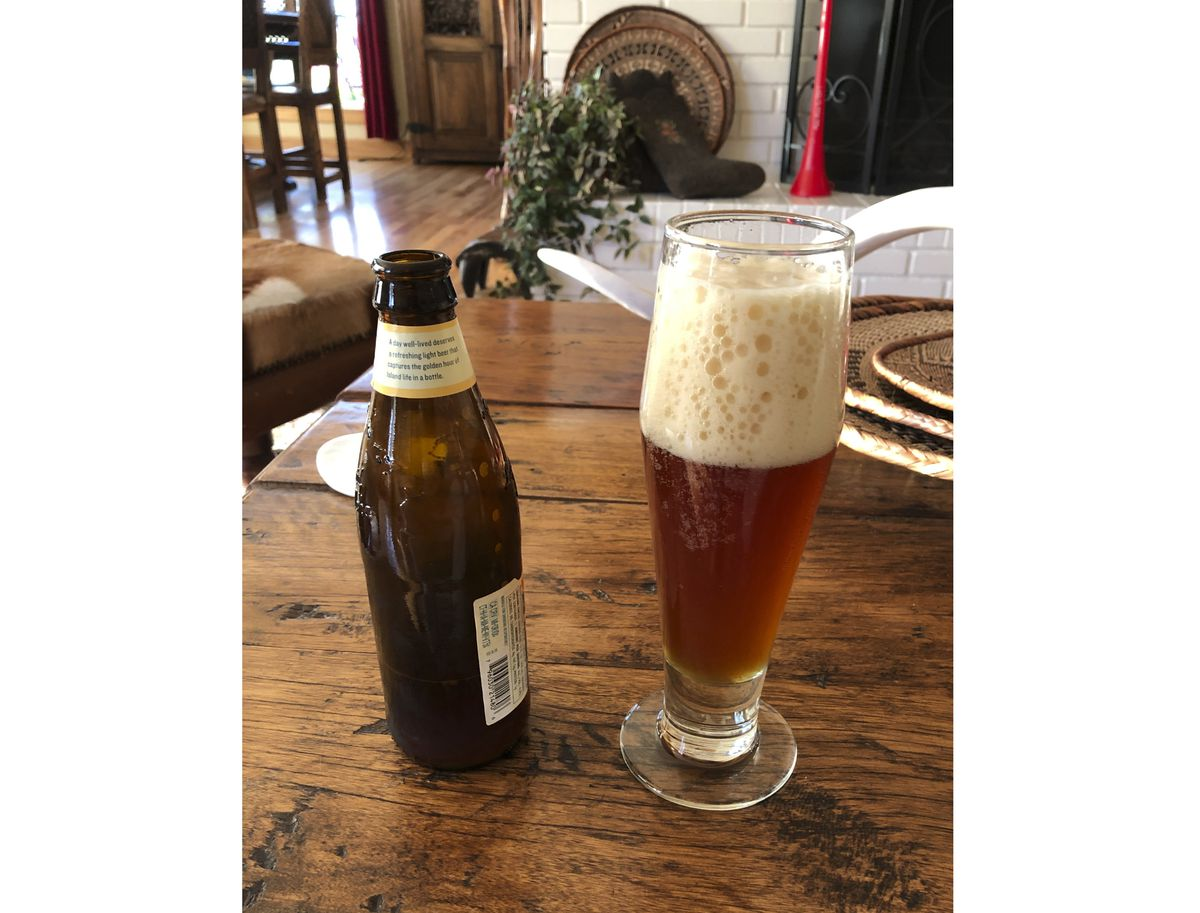 A glass of home-brewed German-style hefeweizen is poured.