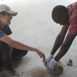 Kathy Ku and a local employee in Uganda make a clay water filter in their factory in Uganda where unclean water is the number one killer of children under age five.
