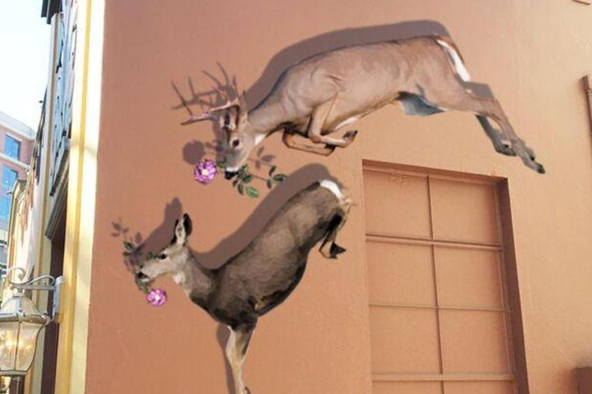 A rendering of leaping dear painted on a wall in Redwood City.