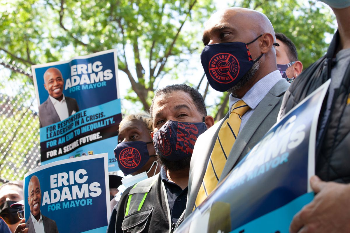 TWU union members support Eric Adams during a campaign event outside the West 4th Street subway station, May 18, 2021.