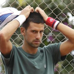 Novak Djokovic of Serbia gestures during a training session of the Monte Carlo Tennis Masters tournament in Monaco, Sunday, April 15, 2012.