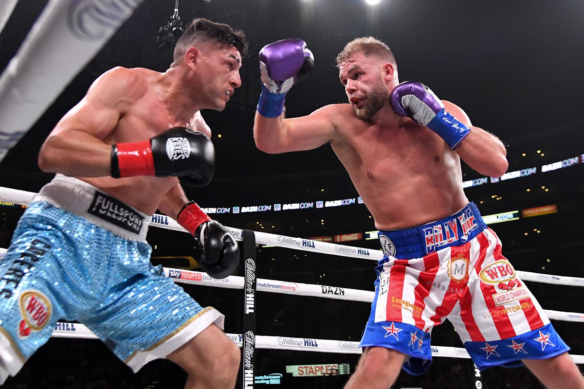 Billy Joe Saunders (red/white/blue shorts) and Marceleo Coceres (light blue shorts) exchange punches during their WBO World Super-Middleweight Championship fight at Staples Center on November 9, 2019 in Los Angeles, California. Saunders won after the fight was stopped in the 11th round.