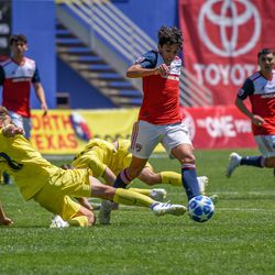 Johan Gomez (9) dribbling past a defender during the opening match of the 40th Annual Dallas Cup.
