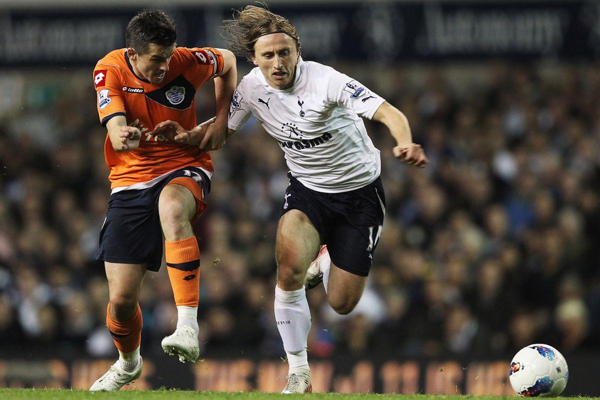 Joey Barton of Queens Park Rangers battles with Luka Modric of Tottenham Hotspur during the Barclays Premier League match between Tottenham Hotspur and Queens Park Rangers.