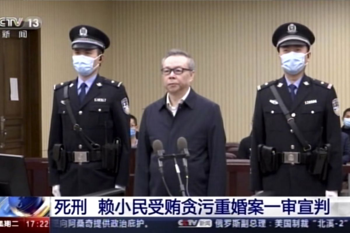 In this image taken from Jan. 5, 2021, video footage run by China's CCTV via AP Video, Lai Xiaomin, the former head of the state-owned China Huarong Asset Management Co., attends court at the Second Intermediate People's Court of Tianjin in China.