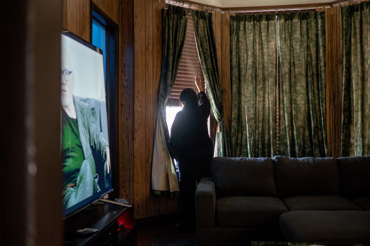 Margarita Gomez, 61, who said she witnessed police fatally shoot 13-year-old Adam Toledo from her window, closes a window in her living room in her home in the 2400 block of South Spaulding Ave. in the Little Village neighborhood, Saturday afternoon, April 3, 2021.