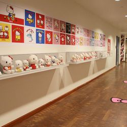 A pretty trail of bows leads you up to the contemporary art portion of the exhibition.