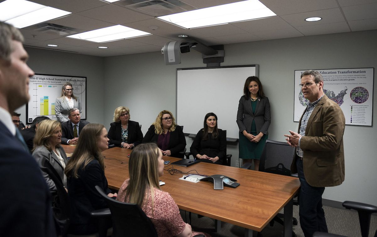 Gov. Bill Lee visits in March with staff members at the state education department, including Commissioner Penny Schwinn (standing, at right).