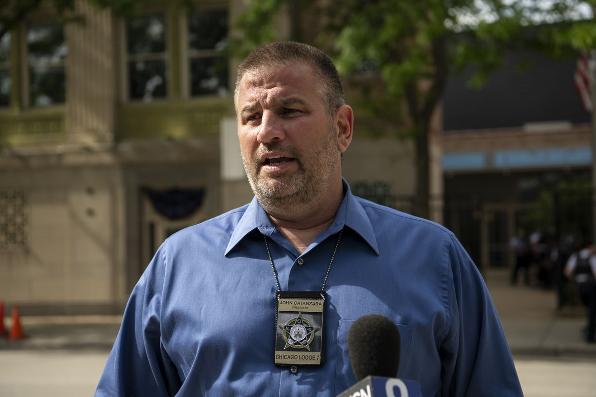 Fraternal Order of Police President John Catanzara speaks to reporters outside the FOP lodge.