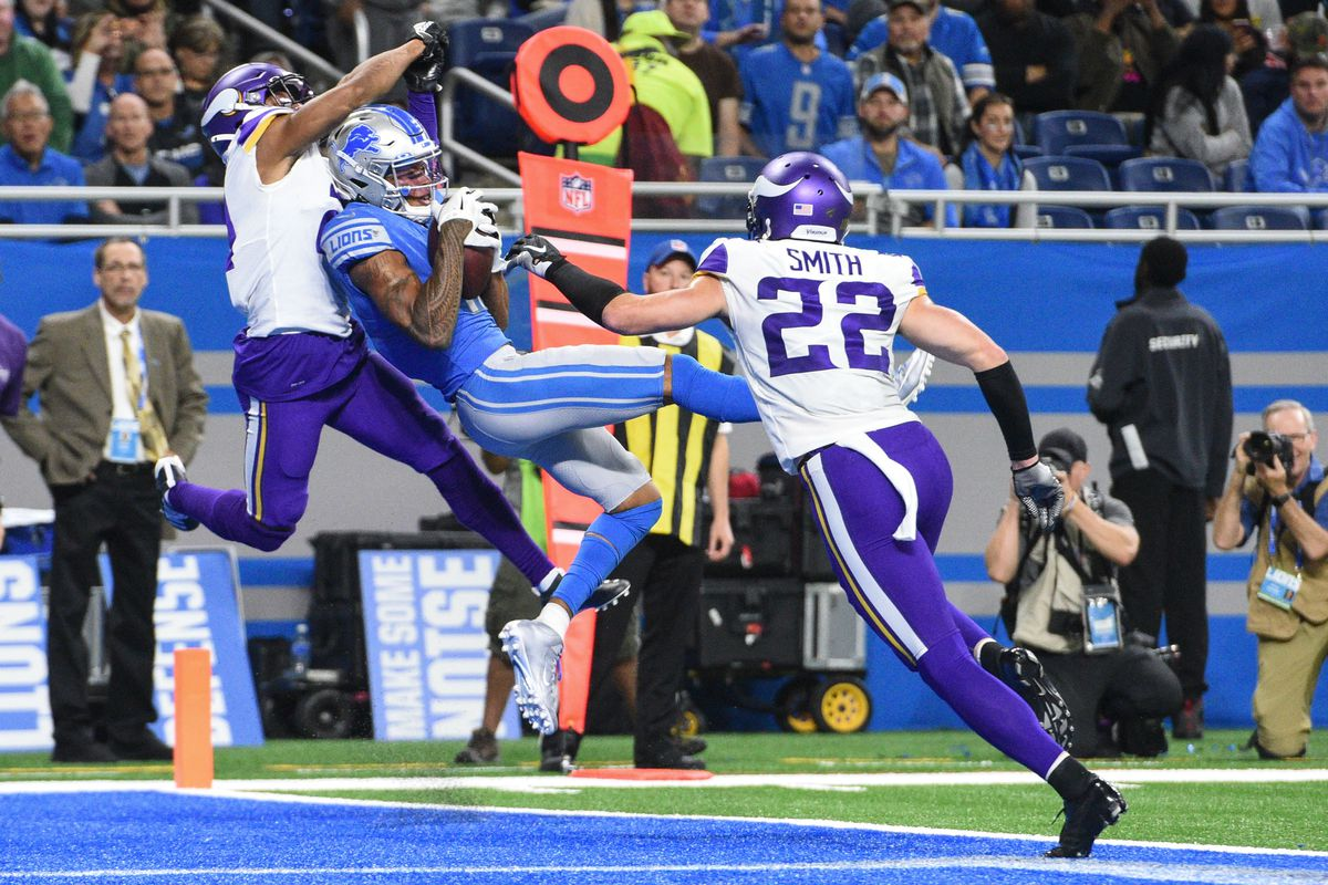 Detroit Lions wide receiver Marvin Jones scores a touchdown as Minnesota Vikings cornerback Mike Hughes and free safety Harrison Smith defend during the second quarter at Ford Field.