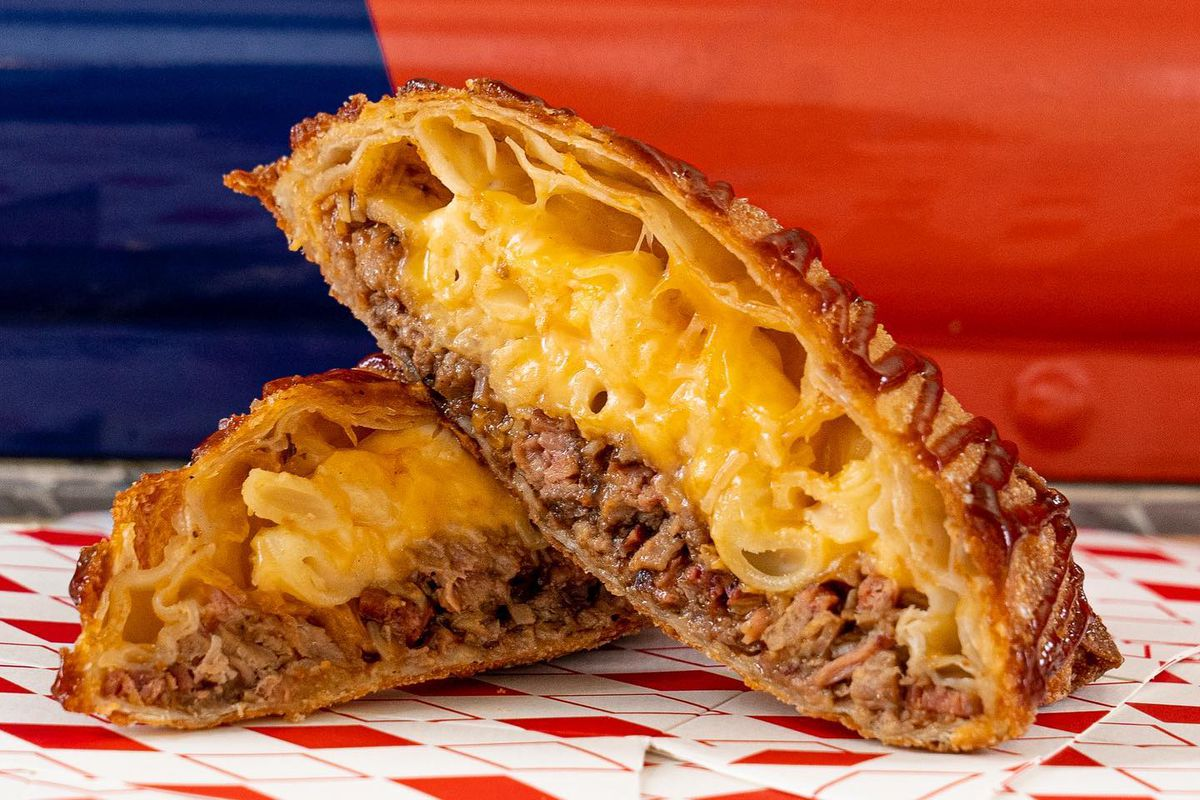 a flaky eggroll stuffed with hamburger meat and cheese