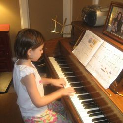 Emily McLaughlin, now 10, practicing as a beginning piano student in 2010.