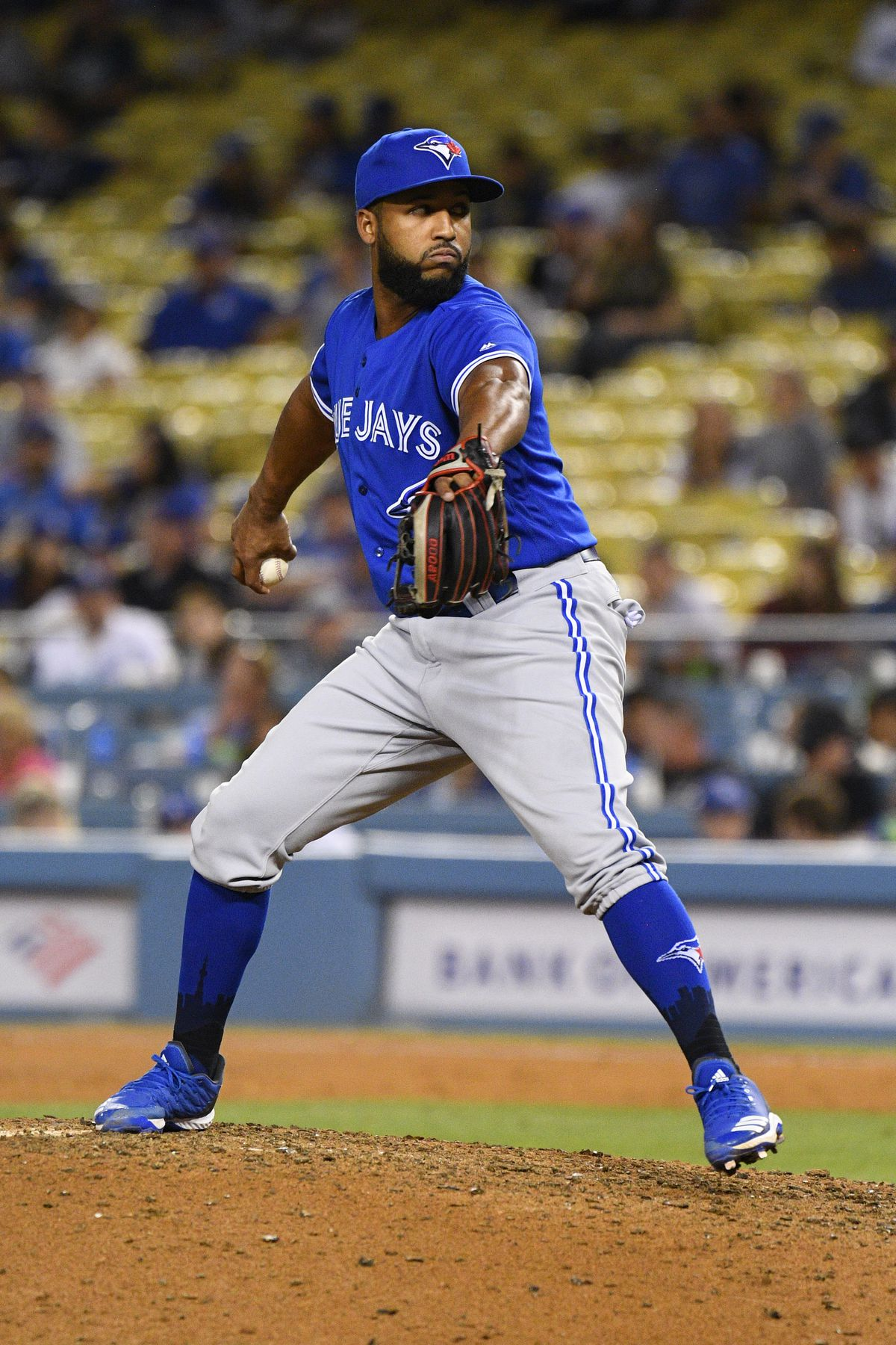Toronto Blue Jays infielder Richard Urena (7) throws a pitch.