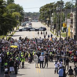 More than a thousand people join the family of Jacob Blake to march through the streets of Kenosha, six days after he was shot in the back by a police officer in the Wisconsin city, Saturday, Aug. 29, 2020.
