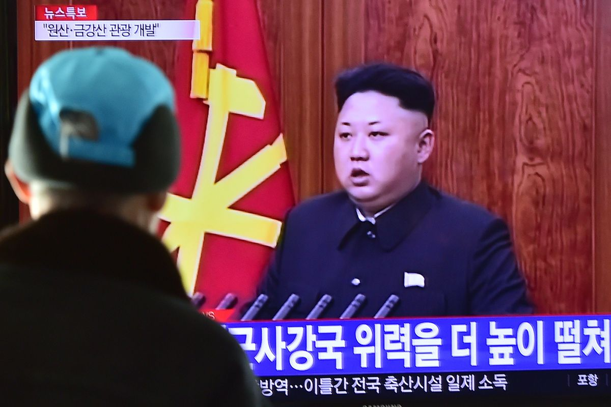 A South Korean man watches North Korean leader Kim Jong Un's 2015 New Year's address.