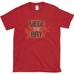 """Click <a class=""""ql-link"""" href=""""https://www.smackapparel.com/collections/tampa-bay-buccaneers-fans/products/siege-the-bay-buccaneers-bucs-shirt"""" target=""""_blank"""">here</a> to purchase your 'Siege the Bay' tee!"""