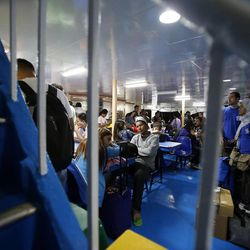 People ride a ferry to Leyte Island in the Philippines, Tuesday, Nov. 19, 2013, following Typhoon Haiyan.