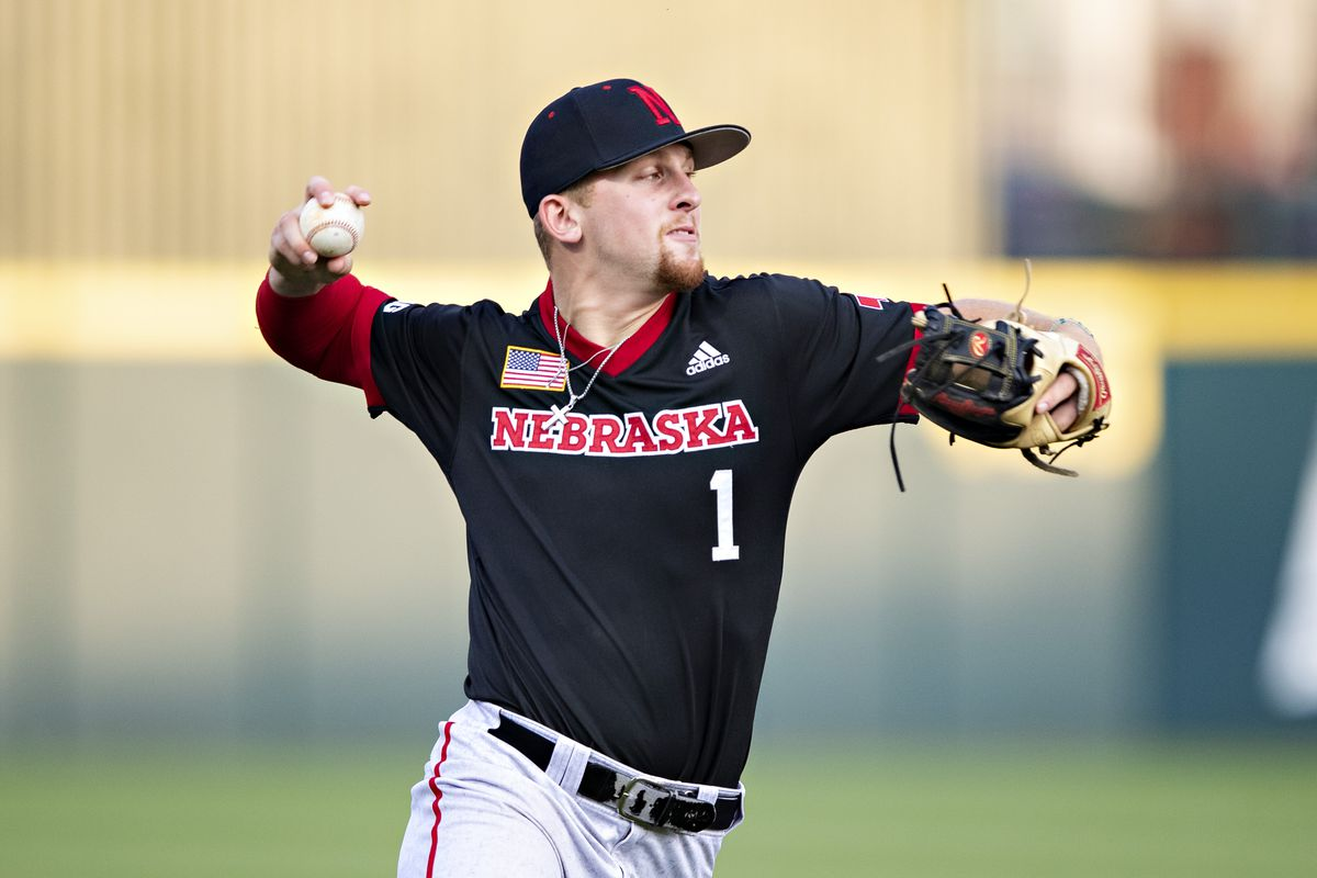 Spencer Schwellenbach #1 of the Nebraska Cornhuskers throws out a runner at first base during a game against the Arkansas Razorbacks at the NCAA Fayetteville Regional
