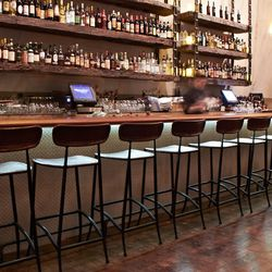 Why not have a drink at the leather-topped bar?