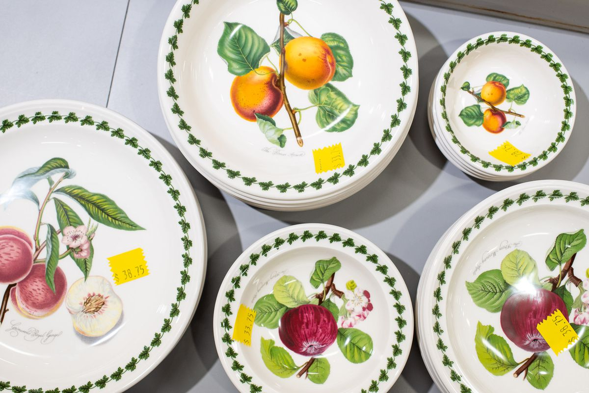 Plates and bowls with fruit decorations.