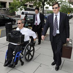FILE - In this July 13,2011 file photo, Assistant U.S. Attorneys Daniel Butler, left, and Steve Durham, leave federal court  in Washington. On a baseball field, players back up teammates to limit the damage from errors. The Justice Department, embarrassed by an error that caused a mistrial of Roger Clemens last year, has added more prosecutors in hopes of containing any missteps as it seeks to convict the famed pitcher of lying to Congress when he said he never used performance-enhancing drugs.