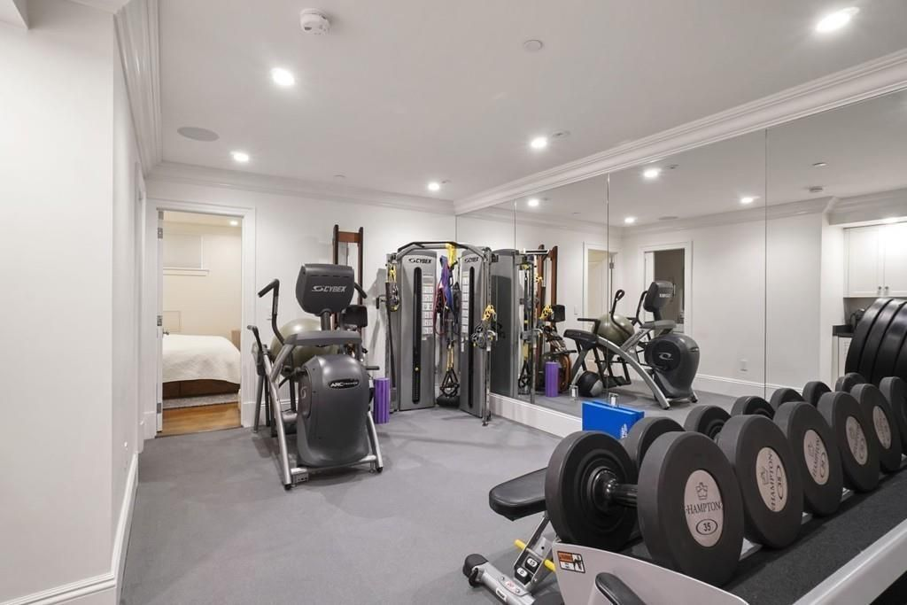 A home gym with weights in the foreground.