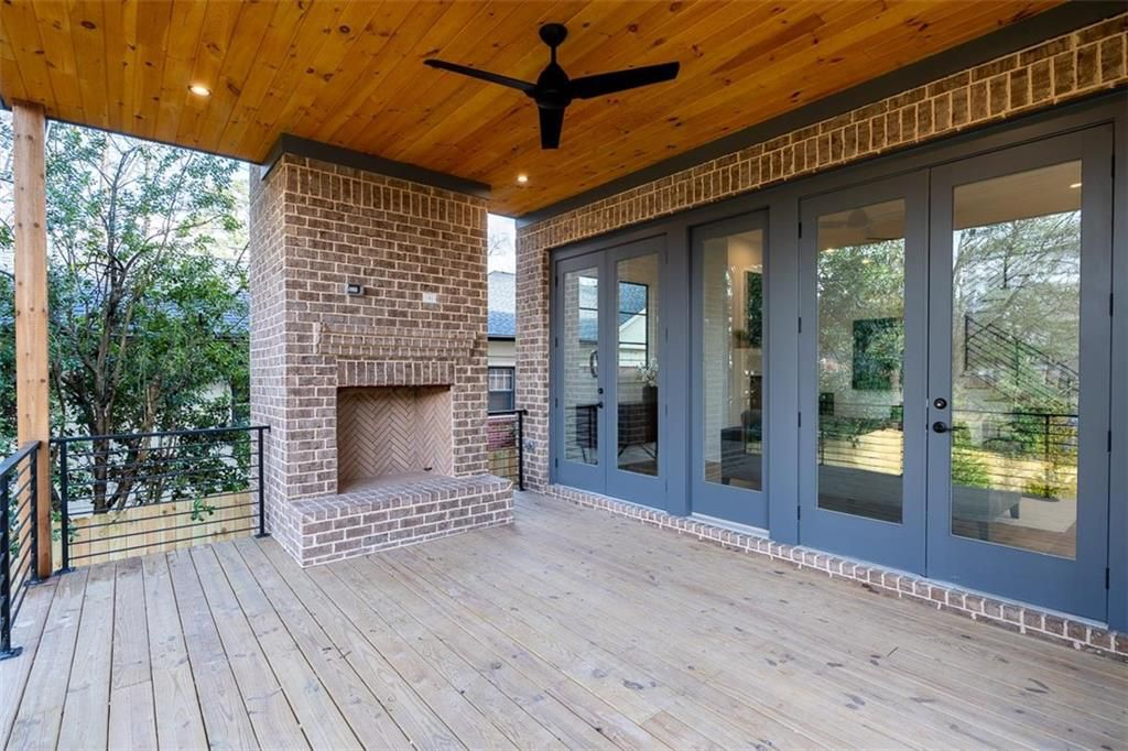 A deck with wood ceilings and a ceiling fan.