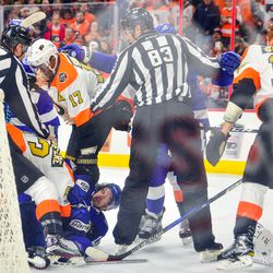A scrum breaks out between several players behind the Flyers' net during the second period.