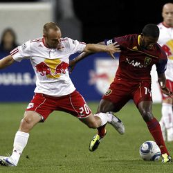 HARRISON, NJ - SEPTEMBER 21:  Joel Lindpere #20 of the New York Red Bulls and Andy Williams #77 of the Real Salt Lake fight for the ball during their game at Red Bull Arena on September 21, 2011 in Harrison, New Jersey.  (Photo by Jeff Zelevansky/Getty Images)