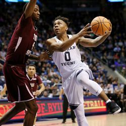 Brigham Young Cougars guard Jahshire Hardnett (0) goes around Texas Southern Tigers center Trayvon Reed (5) for a shot as BYU and Texas Southern play an NCAA basketball game in Provo at the Marriott Center on Saturday, Dec. 23, 2017. BYU won 73-52.