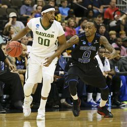 Baylor's Royce O'Neale moves the ball past Georgia State 's Kevin Ware (0) during the first half of an NCAA tournament second round college basketball game, Thursday, March 19, 2015, in Jacksonville, Fla.  (AP Photo/Chris O'Meara)
