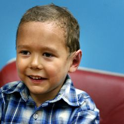 Kamden Gill, 5, smiles after having his bandages removed by Dr. Steven Mobley at the Surgical Specialty Center in Salt Lake City on Friday, Sept. 23, 2011. Mobley performed an otoplasty to fix Kamden's protruding ears.