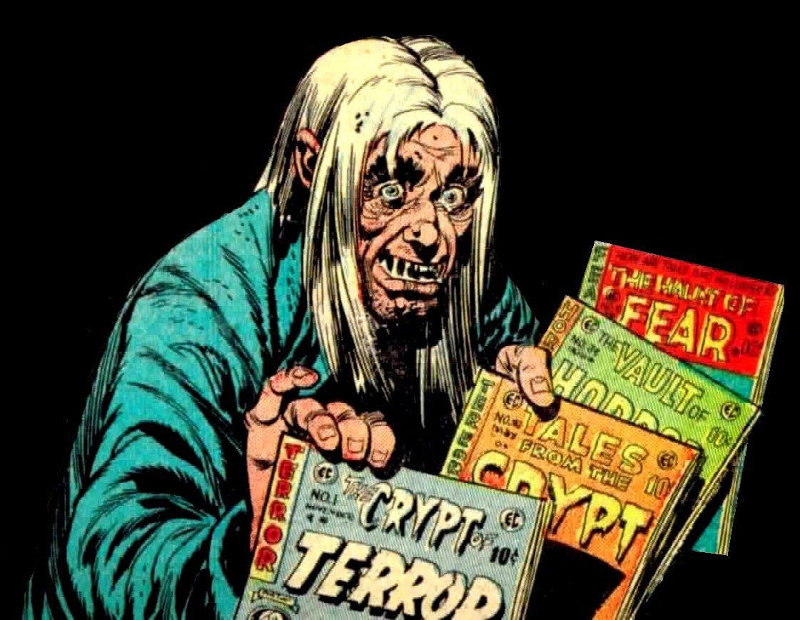 The creepily-grinning Cryptkeeper offers a selection of EC Comics horror titles to the viewer.