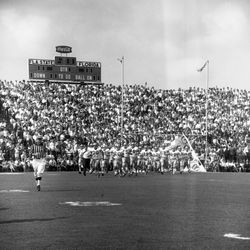 1966-FSU football players taking the field at Doak Sheridan Campbell Stadium in Tallahassee for game against UF.