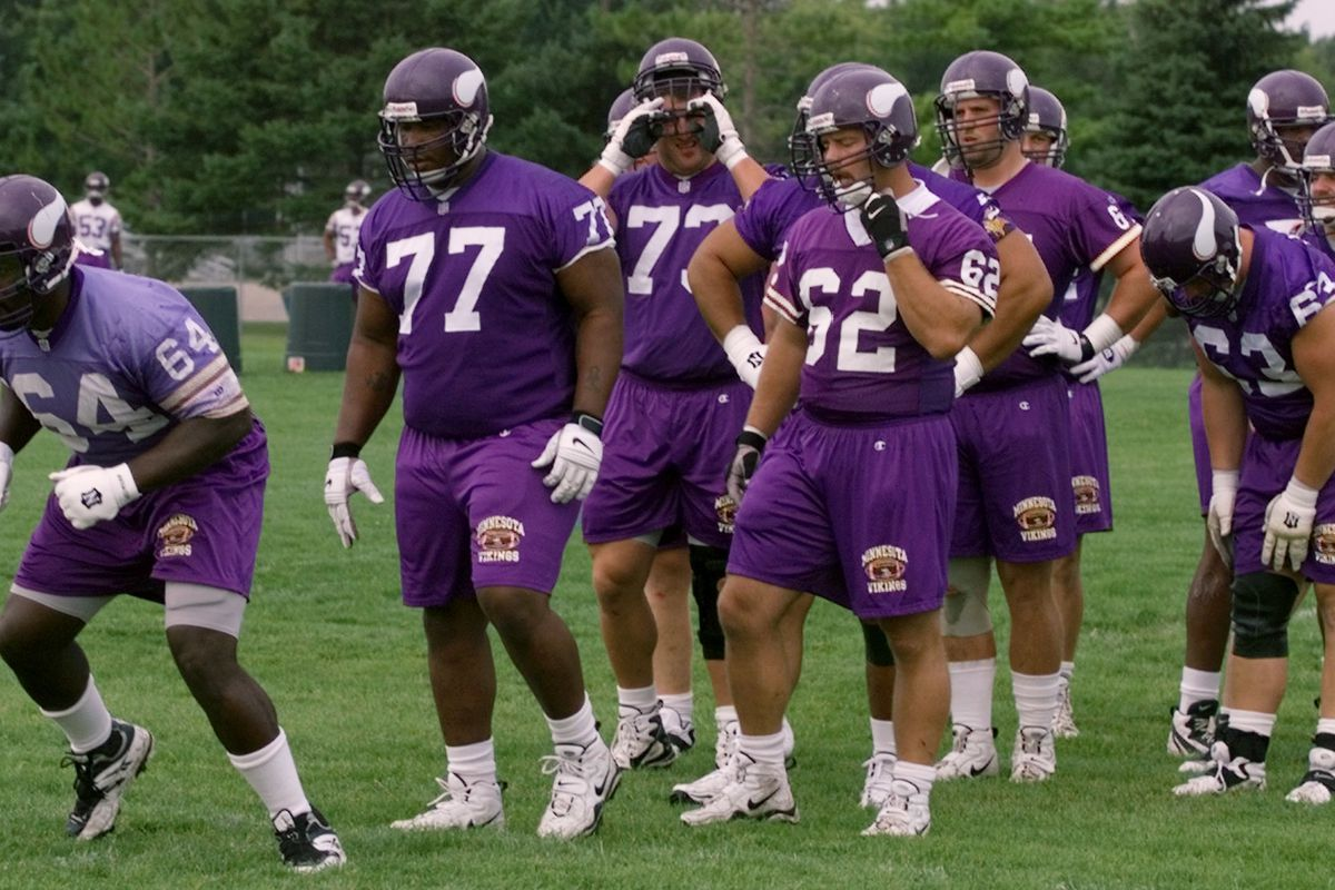 Mankato, MN 8/2/99 - The first day of Vikings training camp in Mankato. — Mankato Mn, 8/11/99....Vikings offensive linemen Randall McDaniel leads a drill during practice at Mankato, following McDaniel his Korey Stringer (77), Todd Steussie (73) and Jef