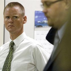"""Dell """"Super Dell"""" Schanze, left, listens to his attorney Harold Stone at the beginning of his criminal case June 7, 2010."""