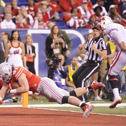 Joey Bosa dives into the endzone for a touchdown