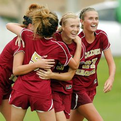 Maple Mountain's #13 Elise Flake, center, is hugged by her teammates after scoring the team's second goal Tuesday, Sept. 25, 2012. Maple Mountain defeated Timpanogos 2-1.