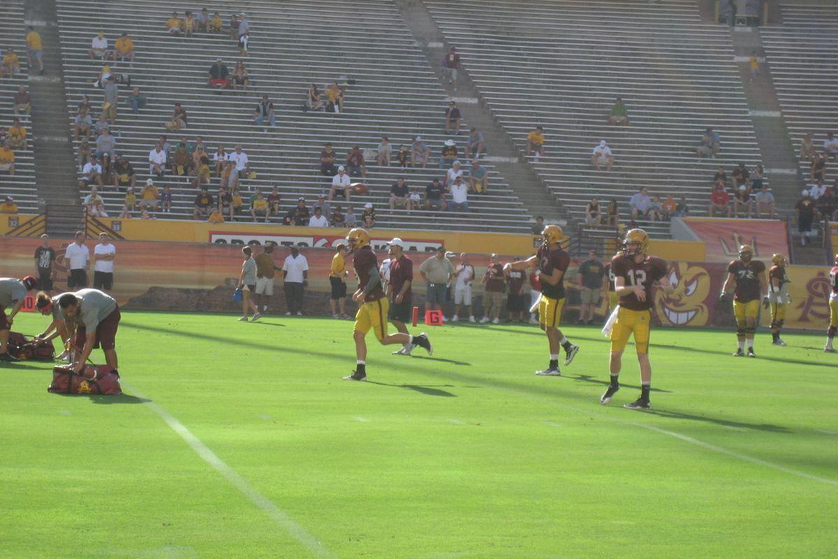 ASU quarterbacks warming up for scrimmage (photo by Jose M. Romero)