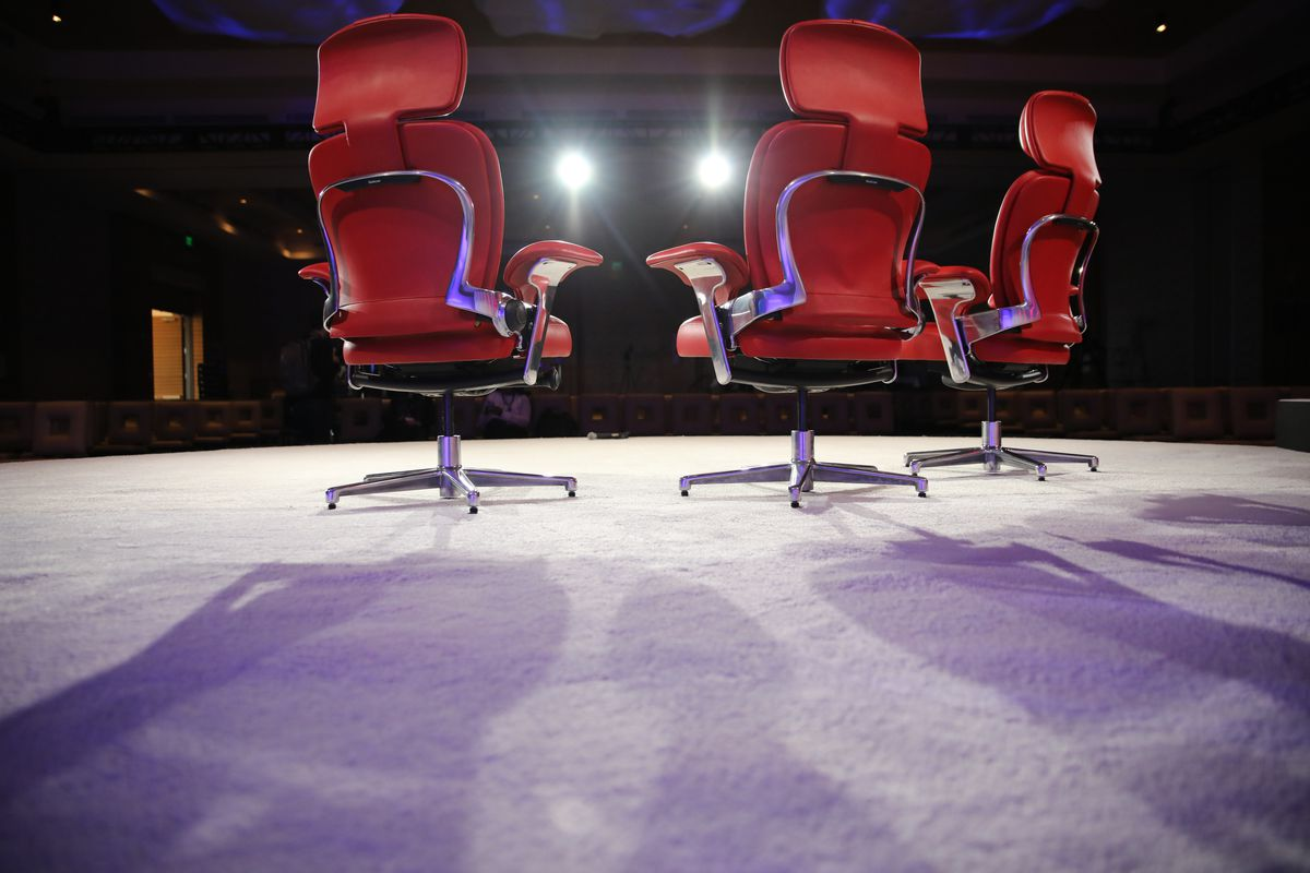 Three red chairs on the Code Media stage
