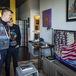 Matt Schreck, 43, and his husband, Fernando Gutierrez, 41, embrace as they watch the inauguration ceremony for President Joe Biden and Vice President Kamala Harris from their South Loop home, Wednesday morning, Jan. 20, 2021.