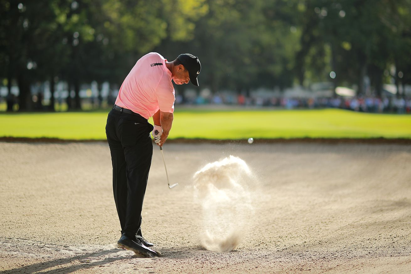 Tiger just after impact on what will be one of the most memorable shots of the year on the PGA Tour.