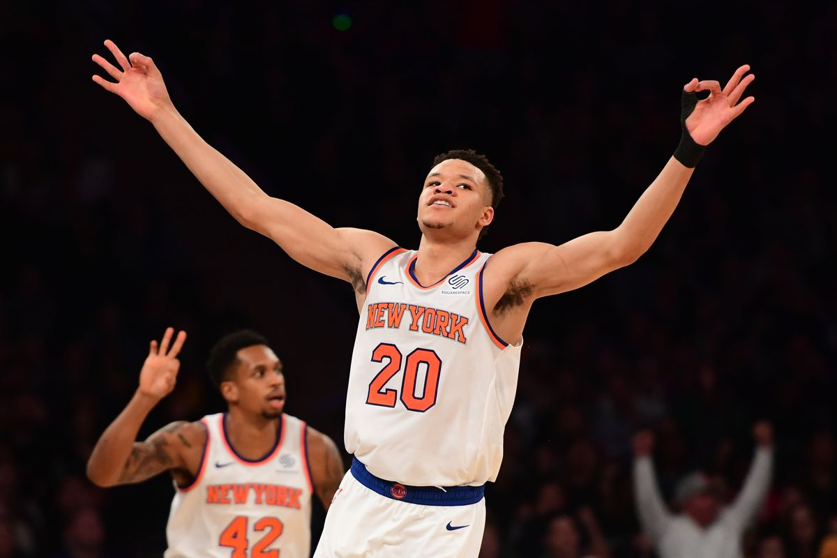 Kevin Knox throws his hands in the air