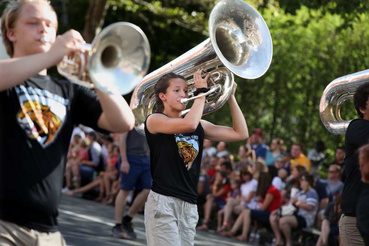 Moriah Carter plays the tuba with the West Jordan High School marching band in the Days of '47 Parade in Salt Lake City on July 24, 2019.