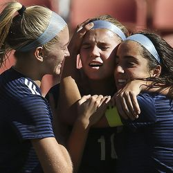 Skyline's Lilly Kimball, center, is congratulated by teammates Laura Cookson and Ani Jensen after scoring against Bonneville in the 5A state championship game at Rio Tinto Stadium in Sandy on Friday, Oct. 25, 2019.