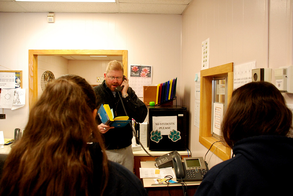 Scott Carpenter principal Chadwick Anderson reads an inspirational quote during the morning announcements.