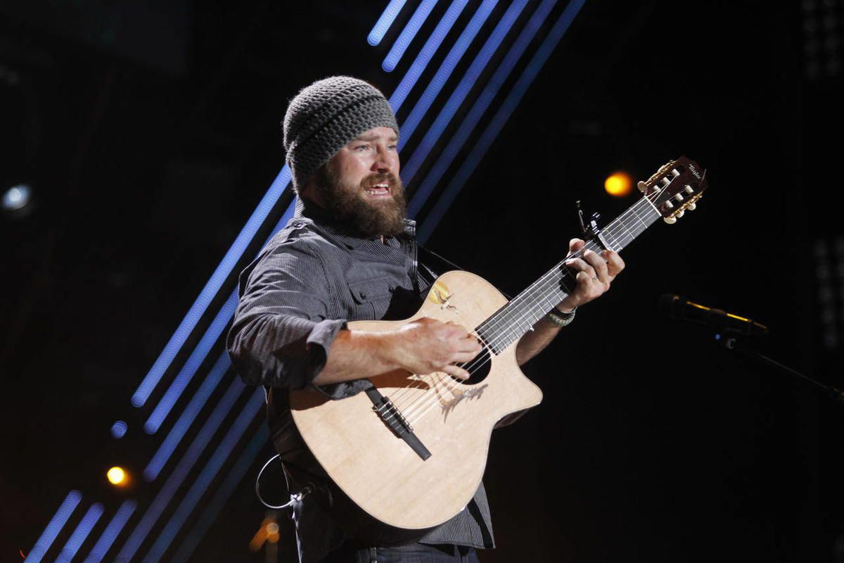 """FILE - In this June 9, 2011 file photo, Zac Brown of the Zac Brown Band performs during the CMA Fan Fest in Nashville, Tenn. The group's latest album, """"Uncaged,"""" is scheduled for release on July 10."""