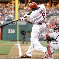 Philadelphia Phillies' Ryan Howard (6) hits an RBI-double off Arizona Diamondbacks pitcher Doug Davis.