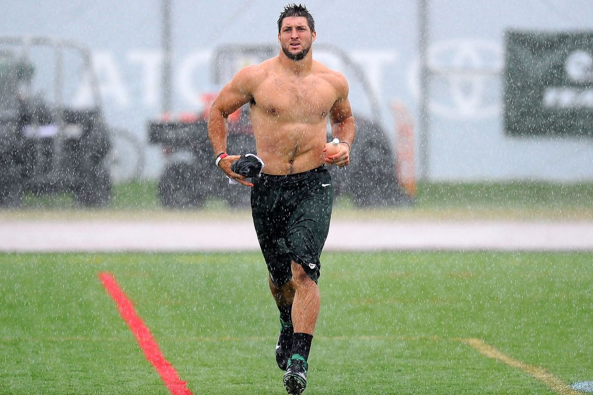 Video tim tebow runs shirtless in the rain with bo derek for Long beach ny shirts